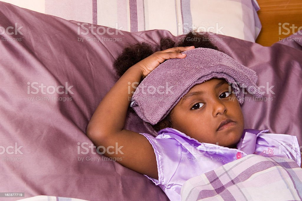 Sick Preschooler in bed stock photo