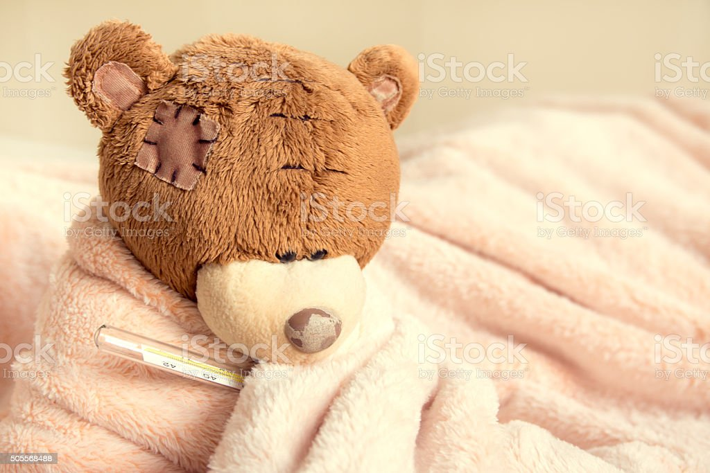 Sick teddy bear stock photo