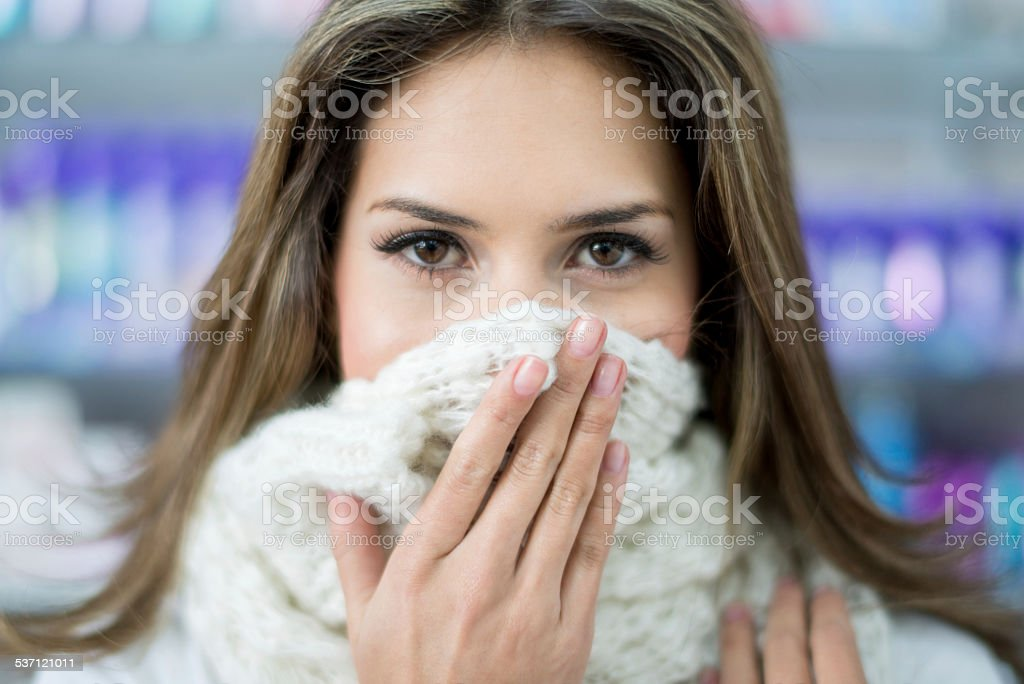 Sick woman at the pharmacy stock photo