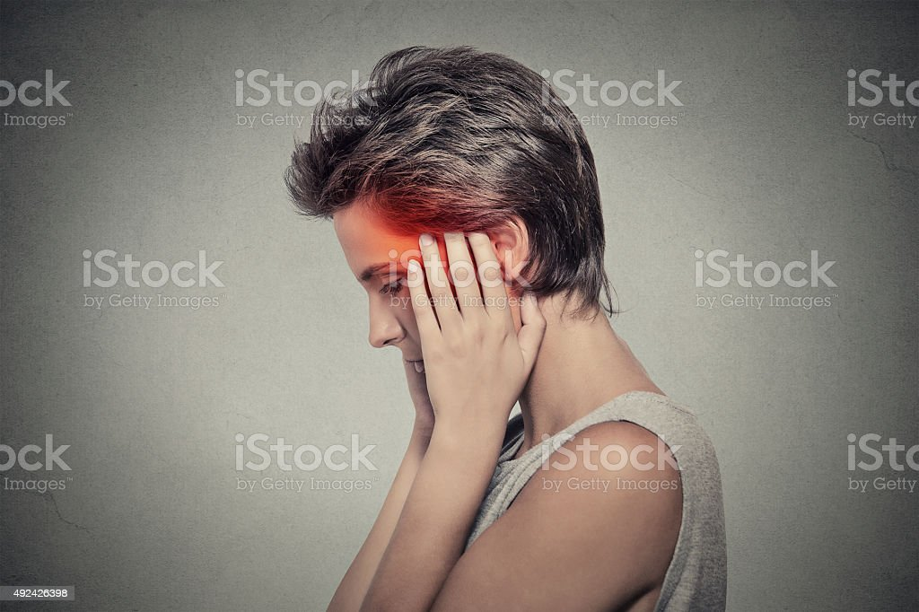 sick woman having ear pain headache. Tinnitus. stock photo
