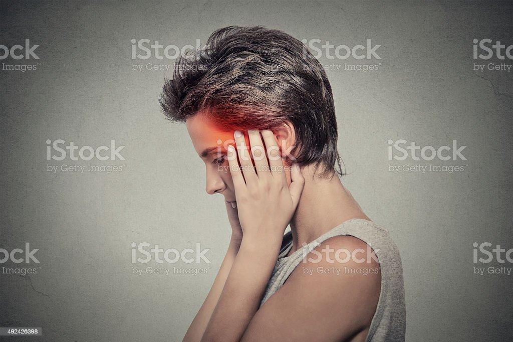 sick woman having ear pain headache. Tinnitus. stock photo