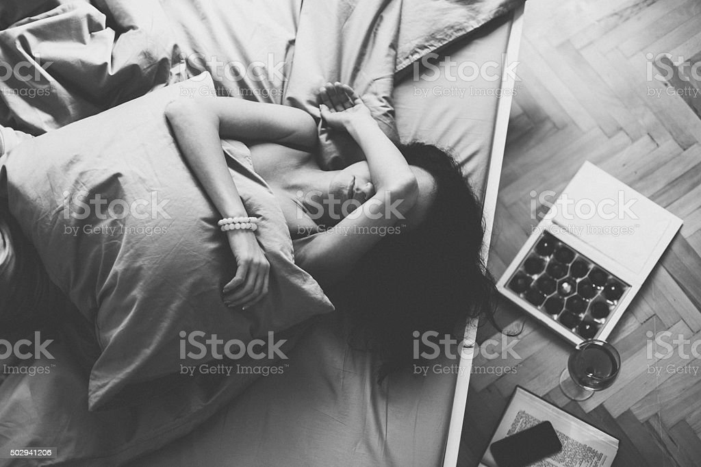 Sick woman in bed stock photo