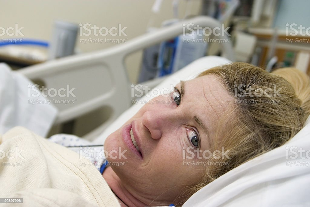 Sick Woman Patient in Hospital Bed stock photo