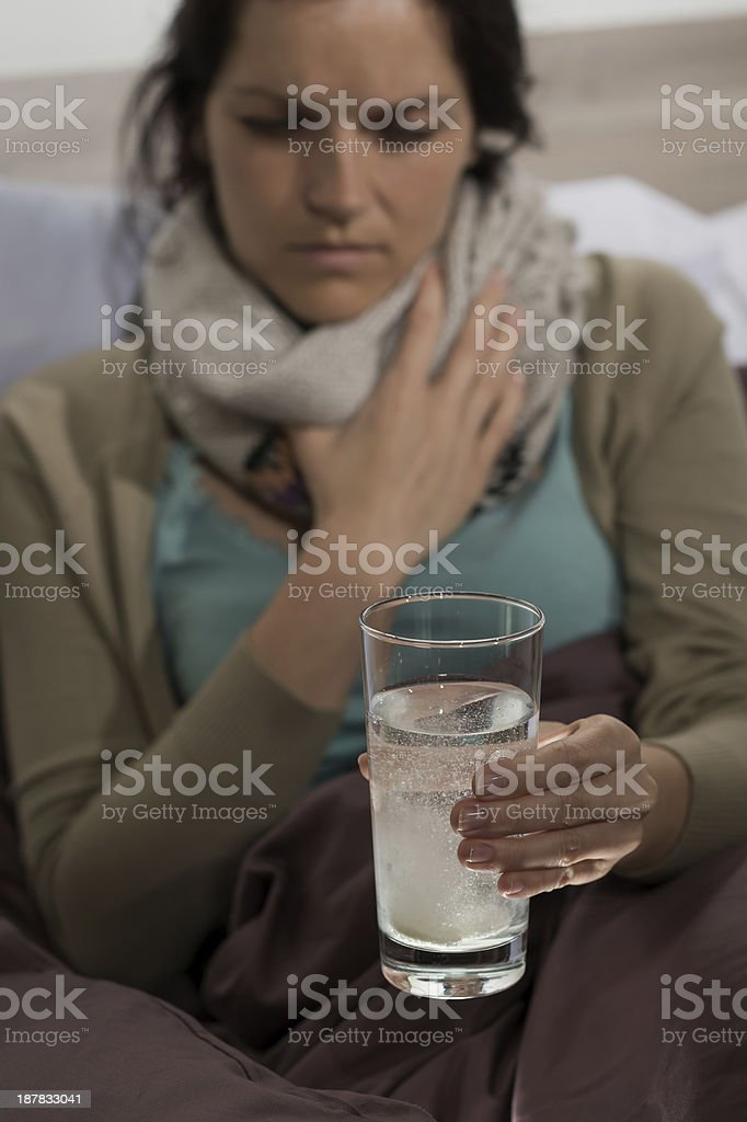 Sick woman preparing cold medicine to drink royalty-free stock photo