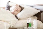 Sick woman sleeping in bedroom