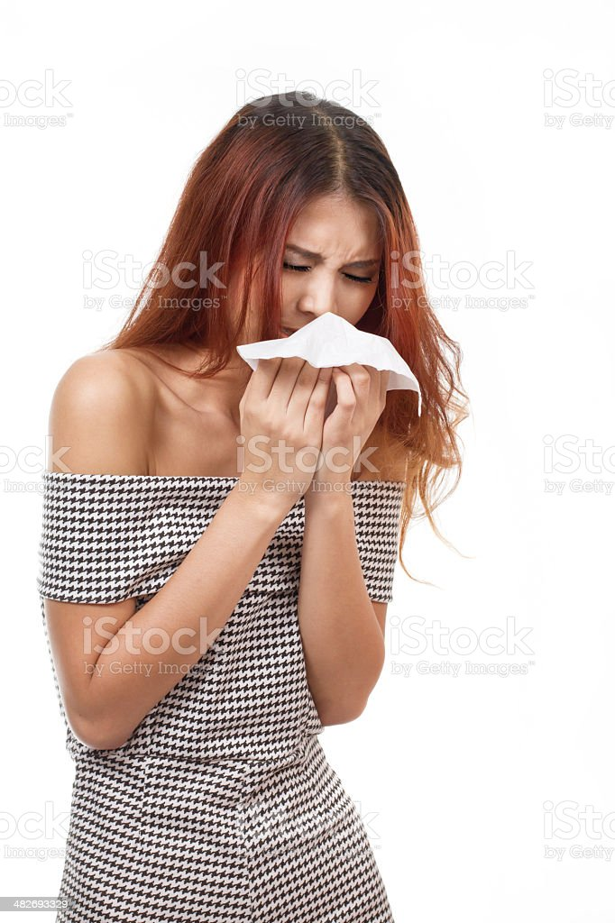 sick woman sneezing due to flu, cold, allergy royalty-free stock photo