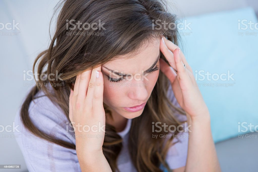 Sick woman suffering from head ache stock photo