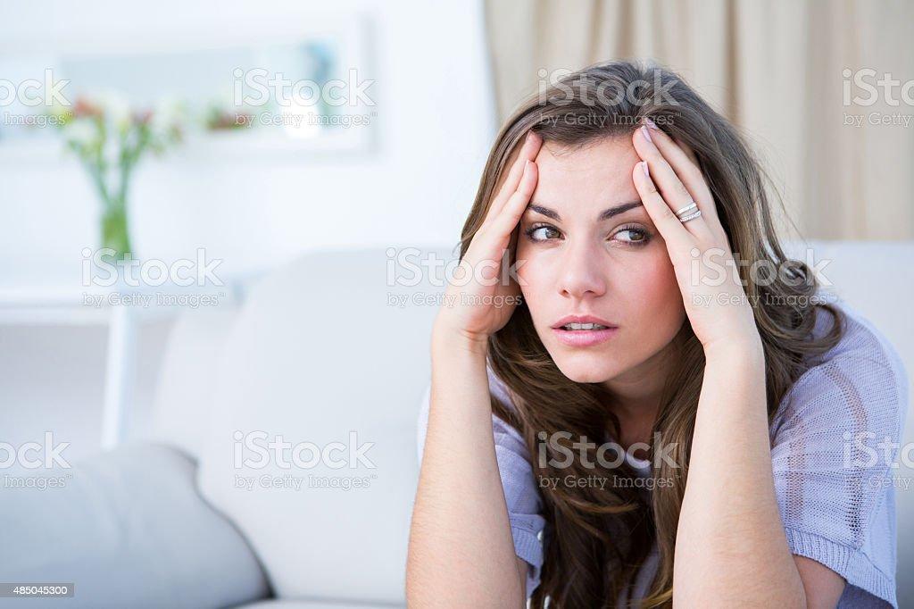 Sick woman suffering from head ache stock photo