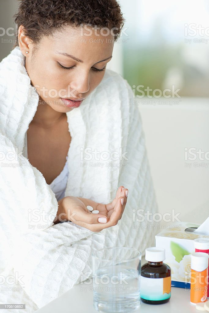 Sick woman taking medicine royalty-free stock photo