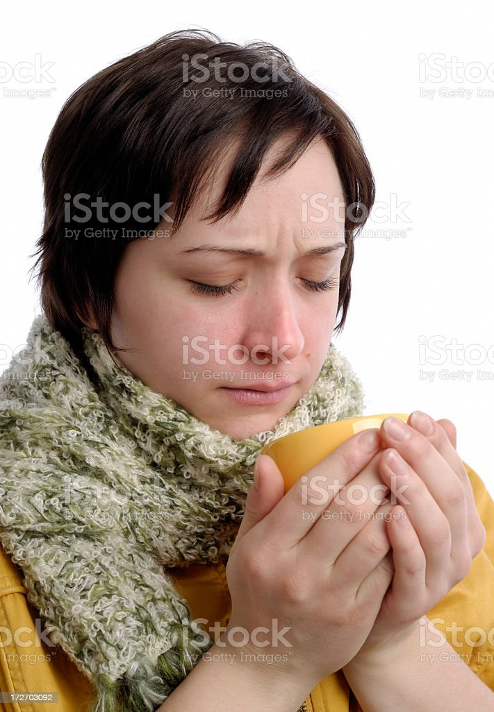 A sick woman wearing a green scarf stock photo