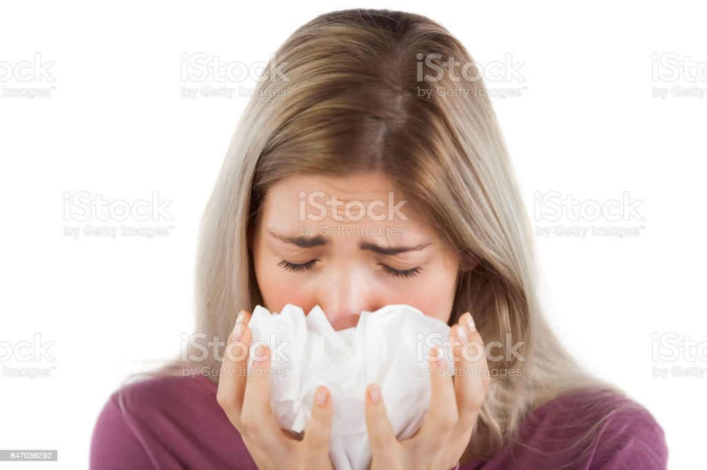 Sick woman with handkerchief on her hands stock photo