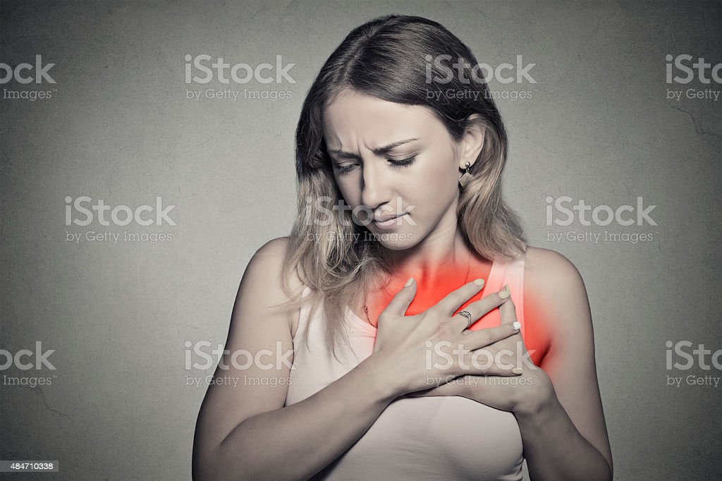 sick woman with heart attack, pain, health problem holding chest stock photo