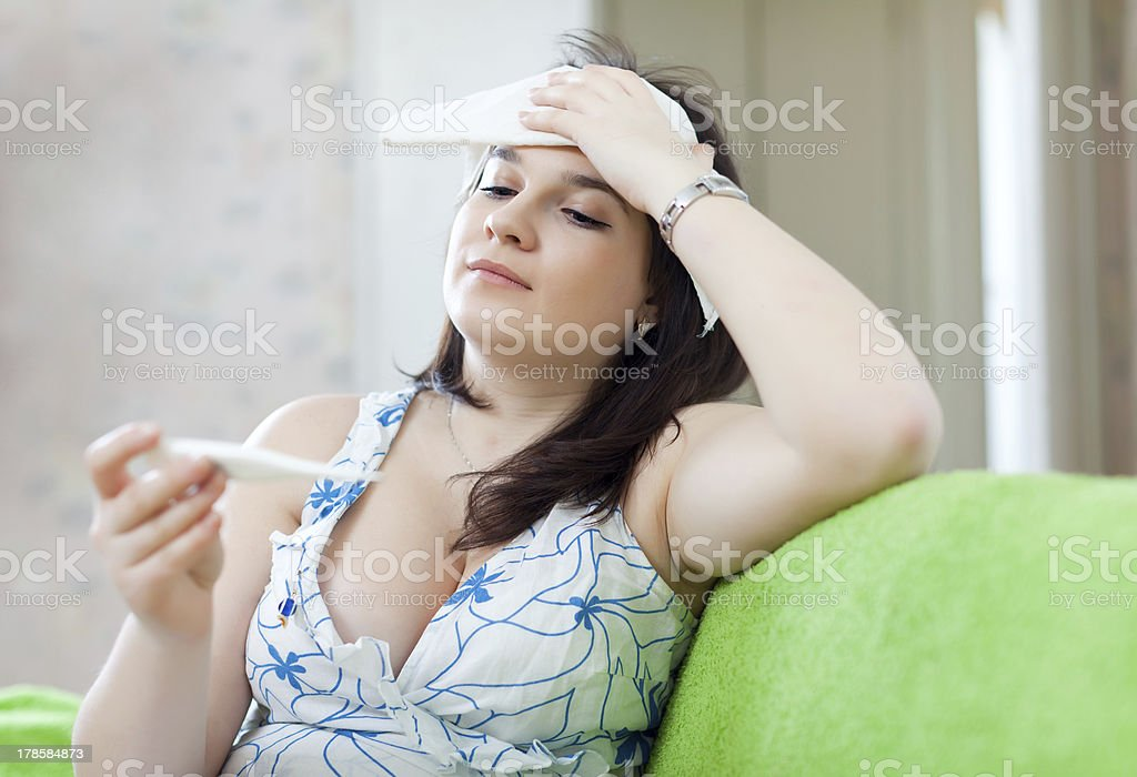 Sick woman with thermometer royalty-free stock photo