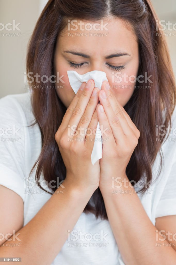 Sick woman with tissue stock photo