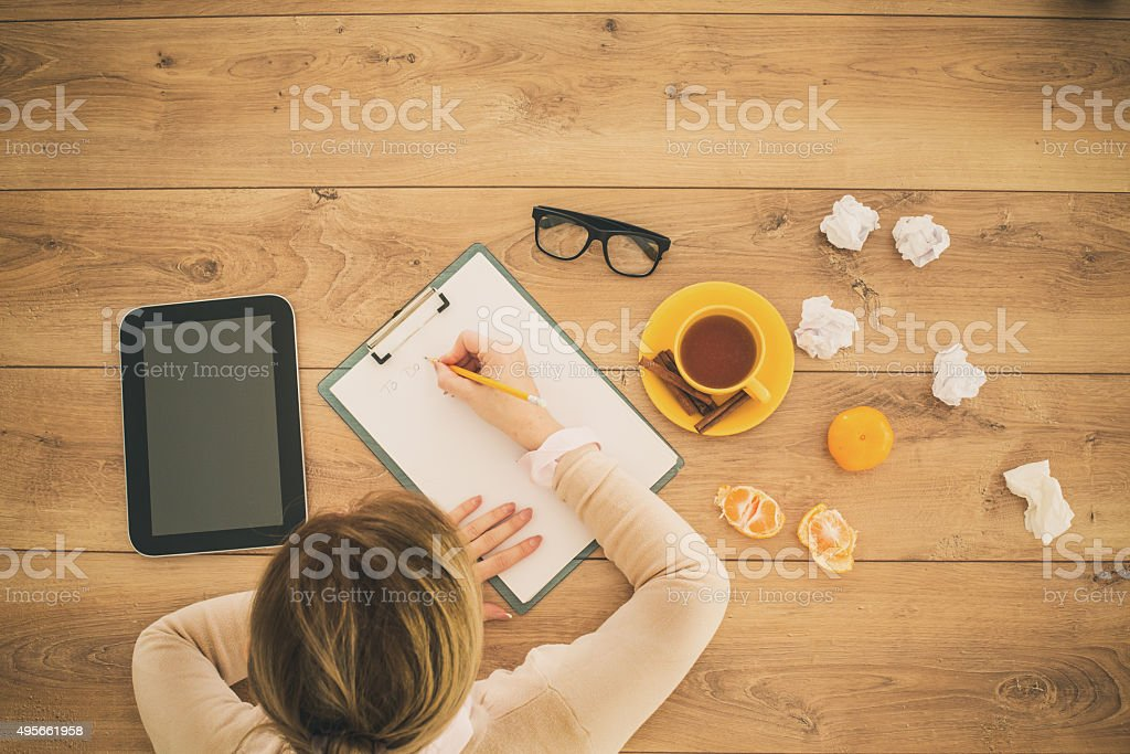 Sick woman working at home stock photo