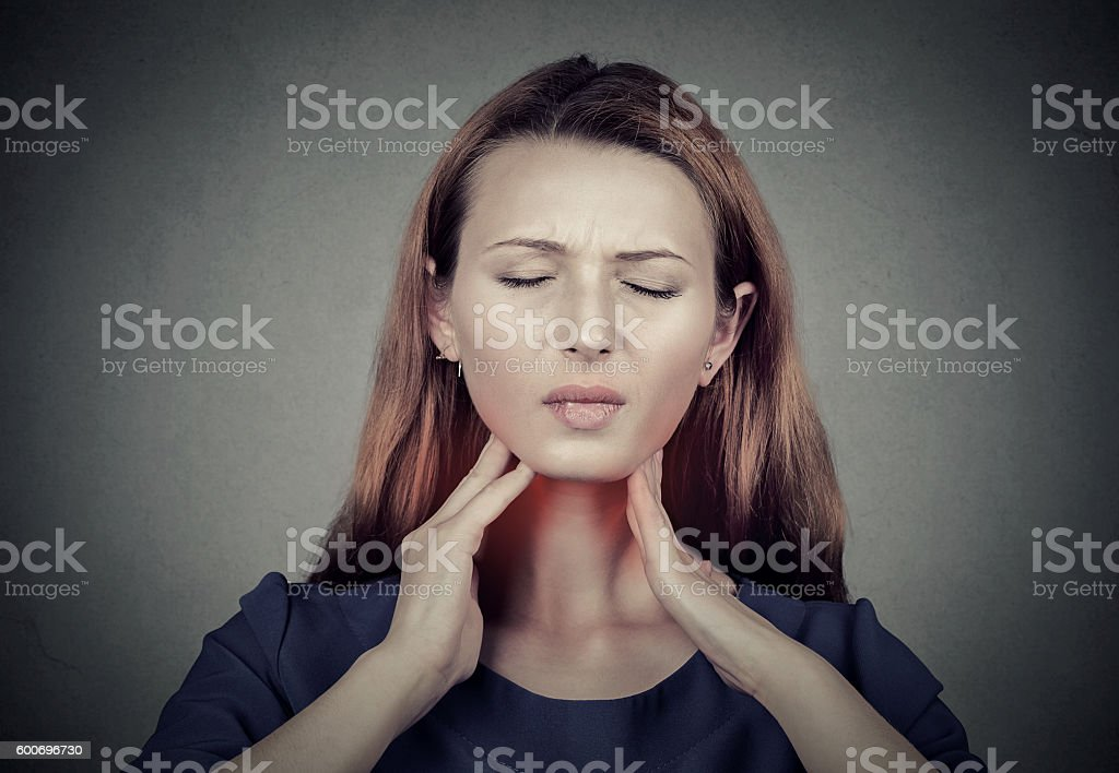Sick young woman having pain in her throat stock photo