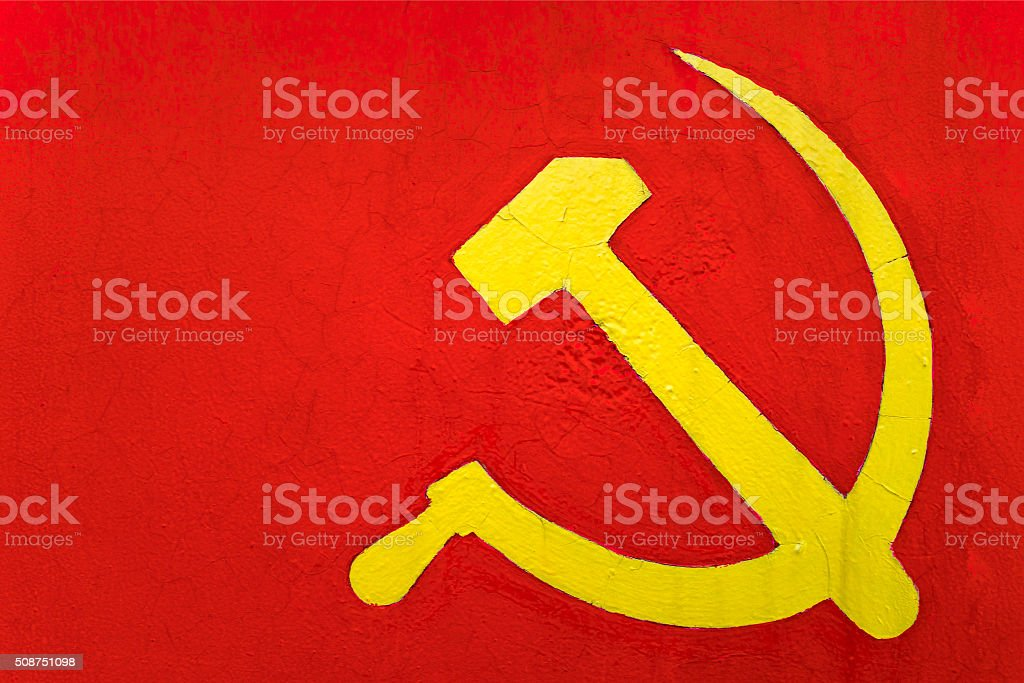 sickle and hammer on a red wall stock photo