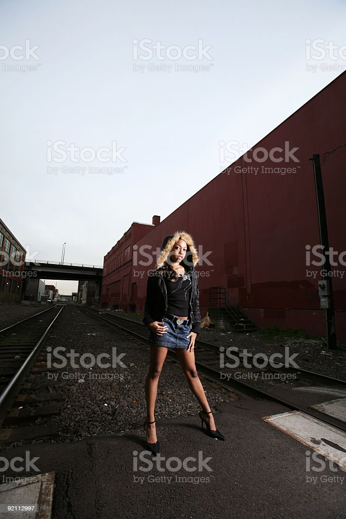 Side Angle Of Young Girl In Abandoned Yard. royalty-free stock photo