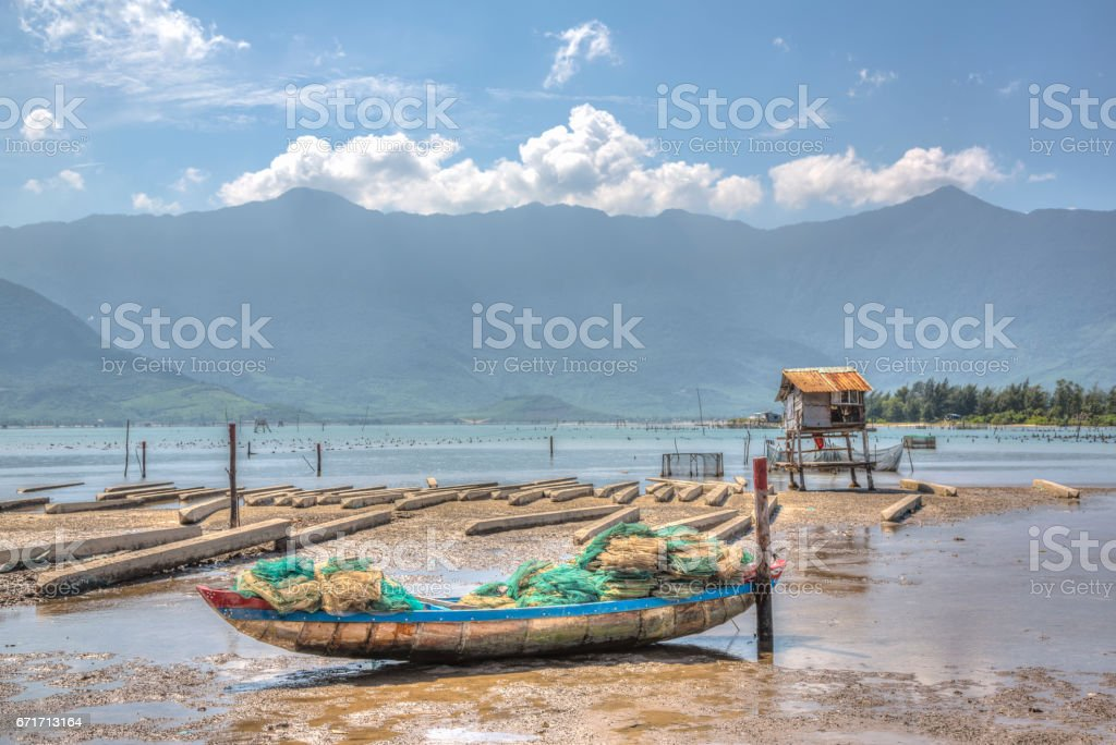 Side boats moored on a vietnam beach stock photo