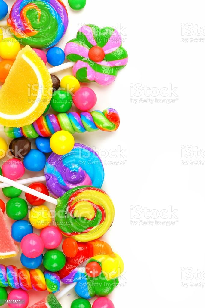 Side border of colorful candies over white stock photo