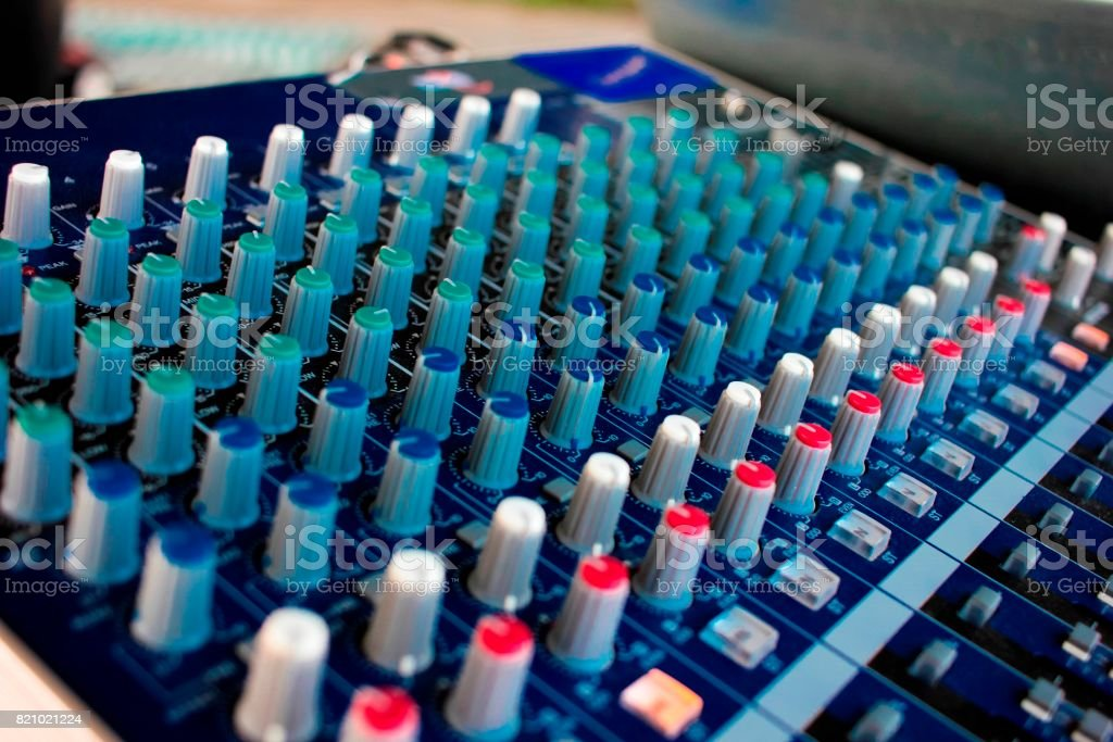 Side closeup of a mixing console with cords. stock photo