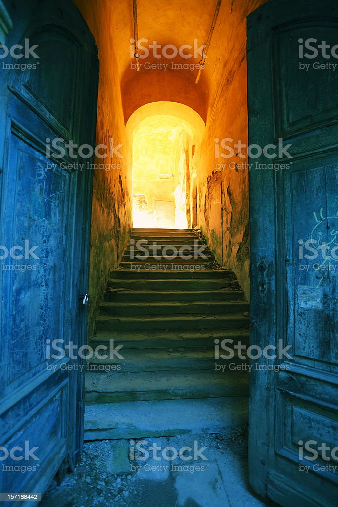 Side entrance of old, abandoned European castle royalty-free stock photo