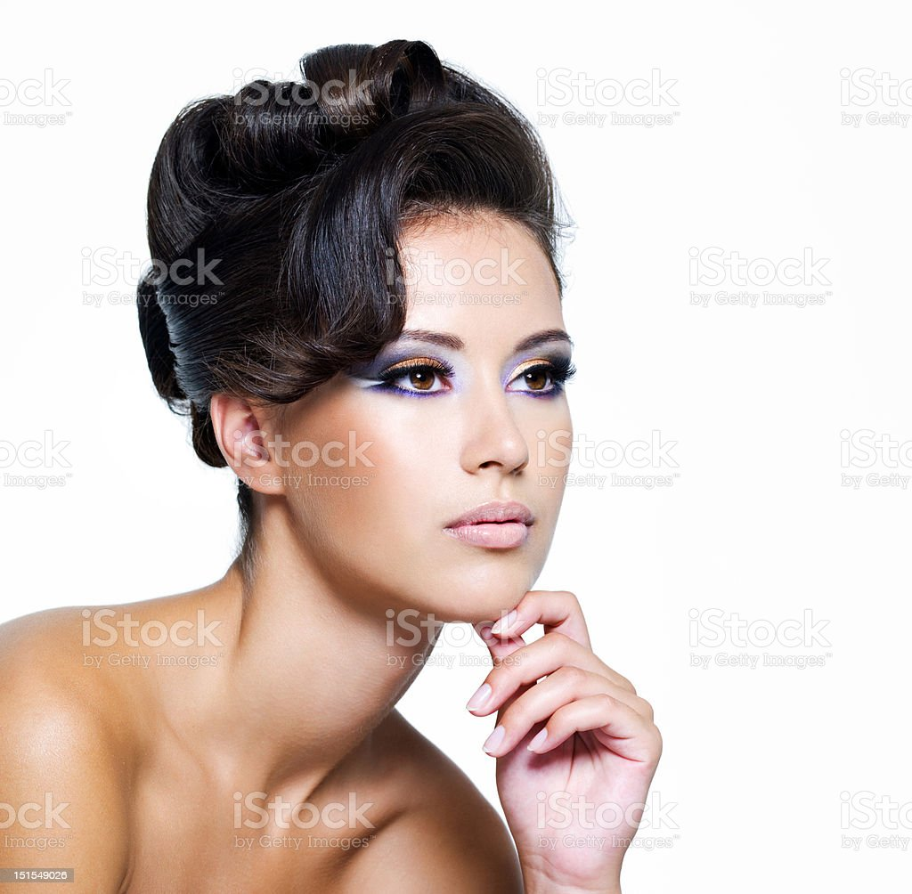 Side facial profile of a shirtless woman with elegant makeup royalty-free stock photo