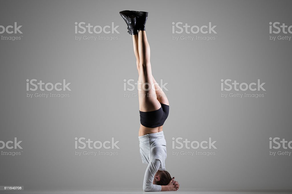 Side Headstand yoga pose stock photo