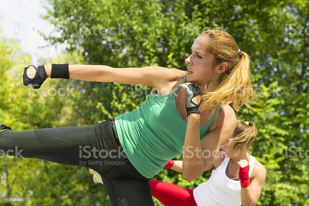 Side Kicks in TaeBo Training stock photo