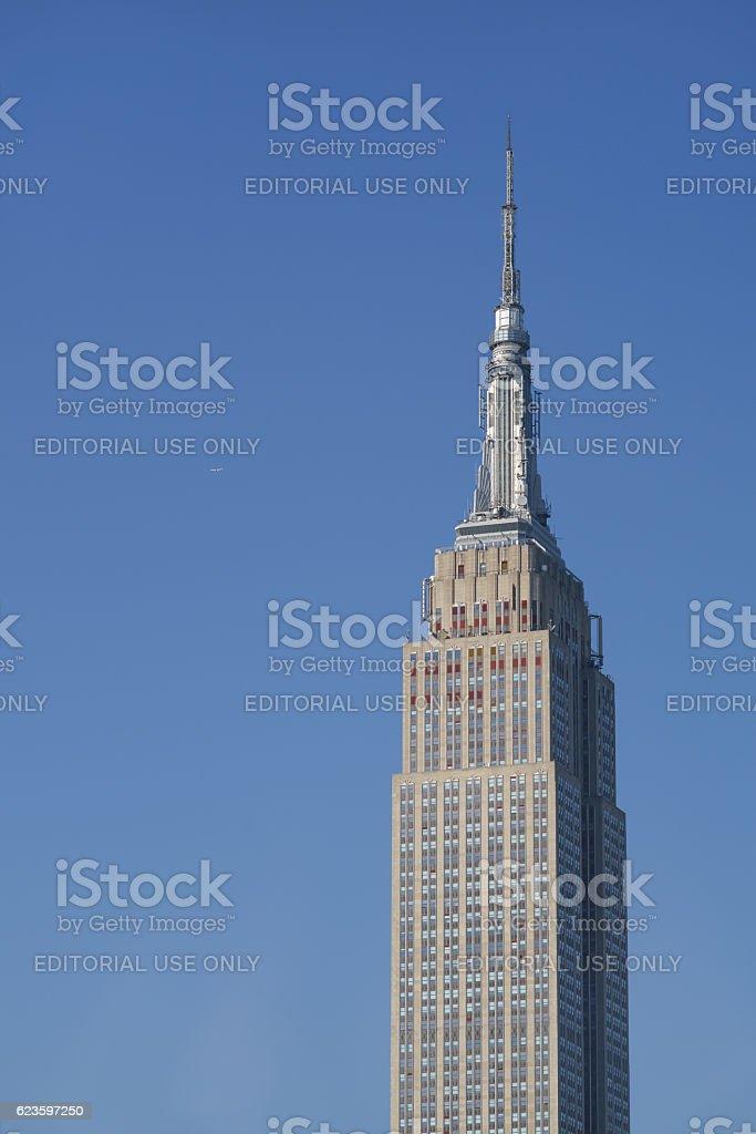Side lit Empire State Building, dark shadows stock photo