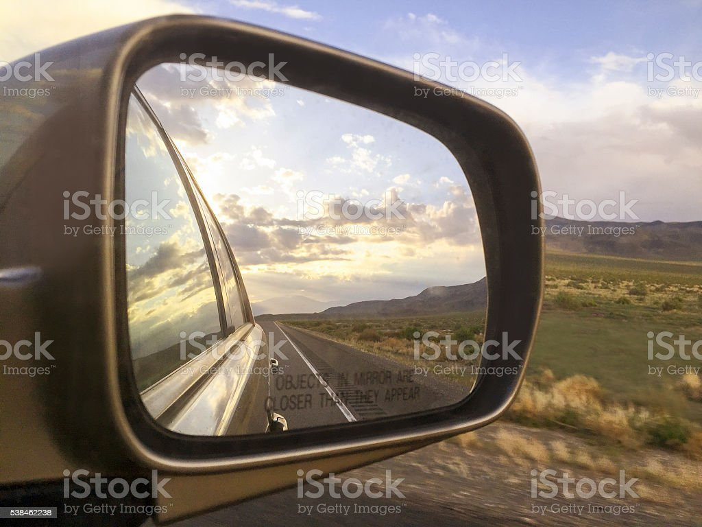 Side mirror view at sunset. stock photo