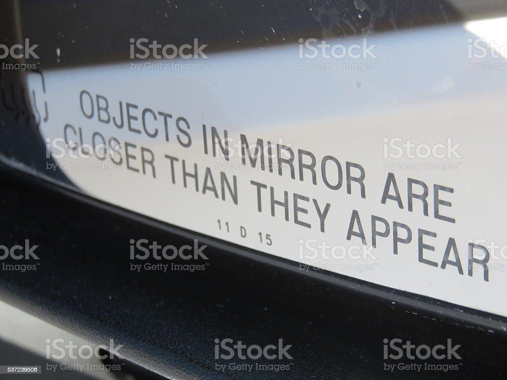 Side mirror warning stock photo