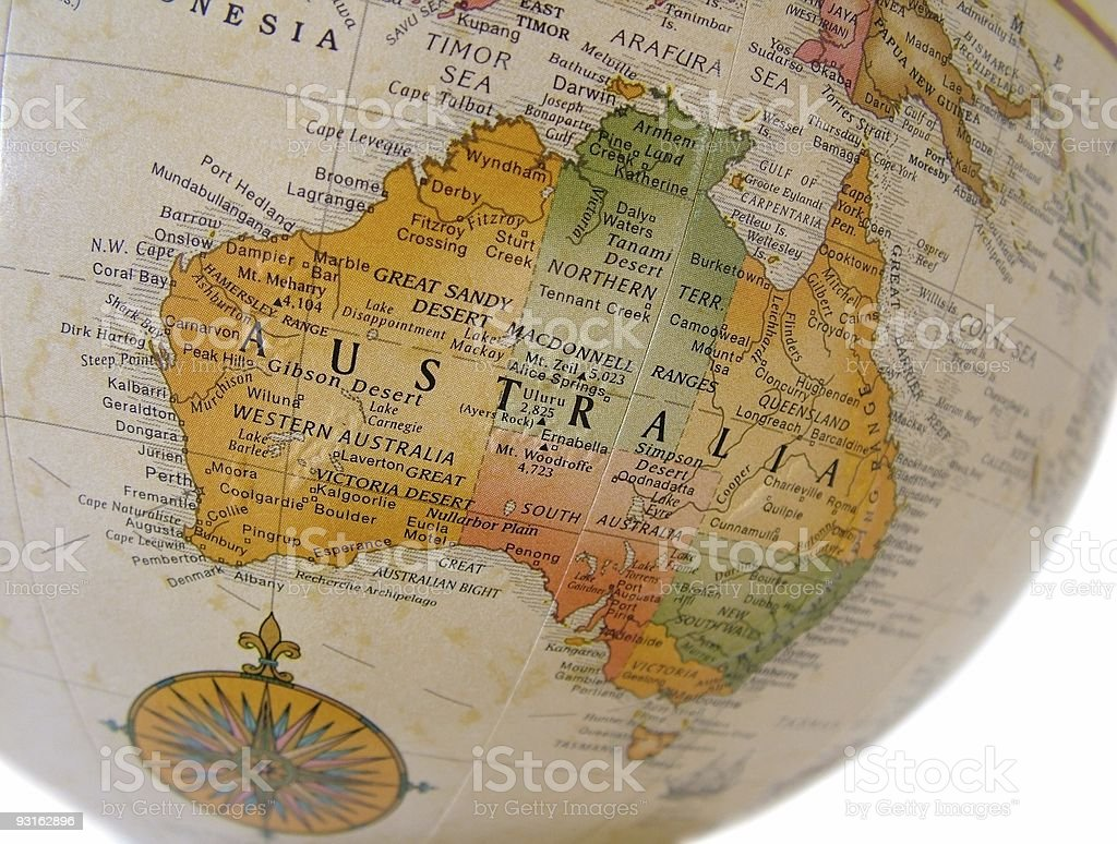 Side of a beige globe with the visible side on Australia royalty-free stock photo