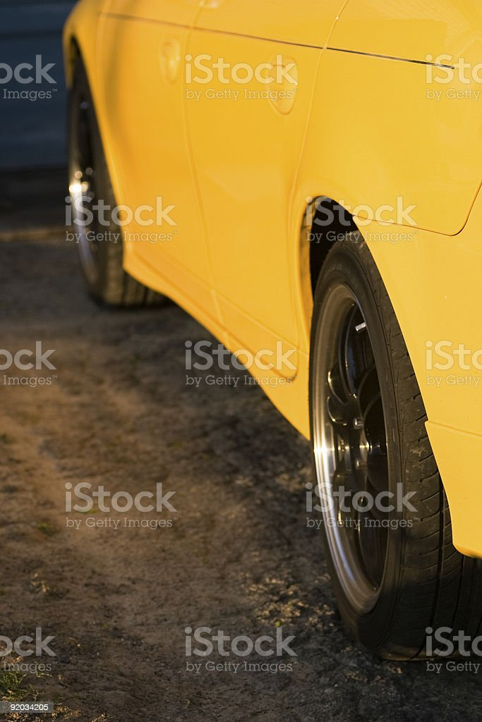 Side of a yellow automobile stock photo