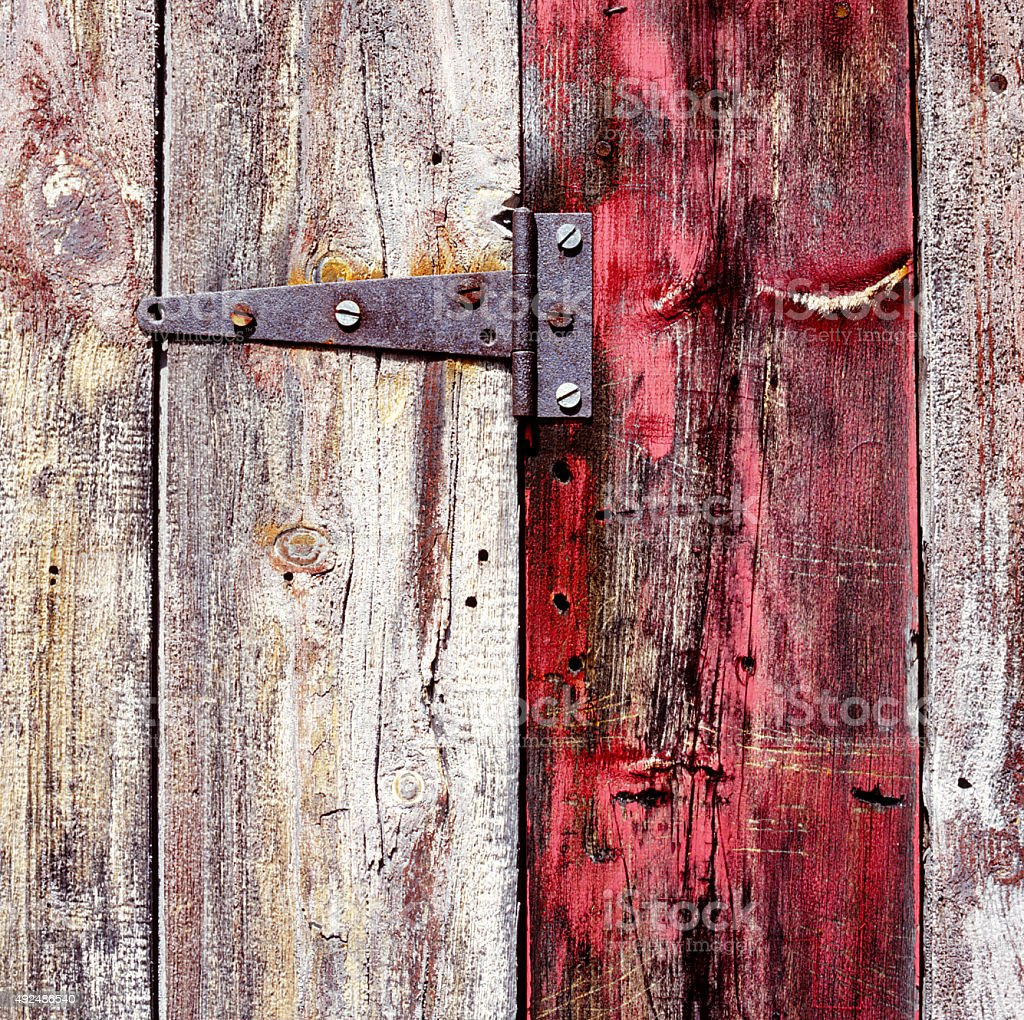Side of an old Barn - Red Board with Hinge stock photo