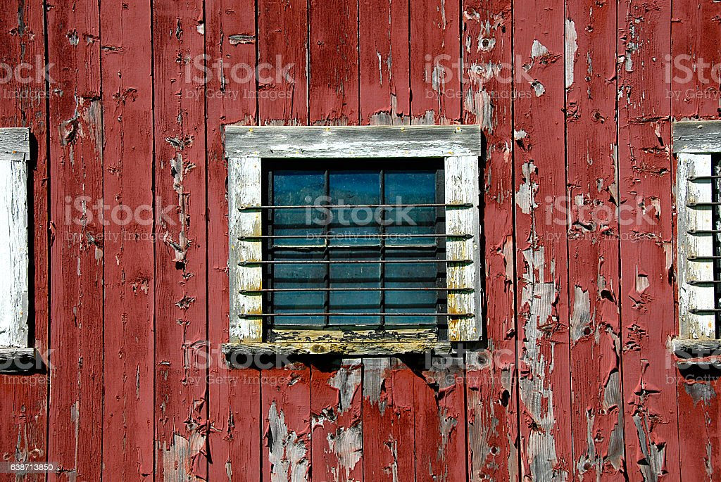 Side of Barn with with Barred Windows stock photo