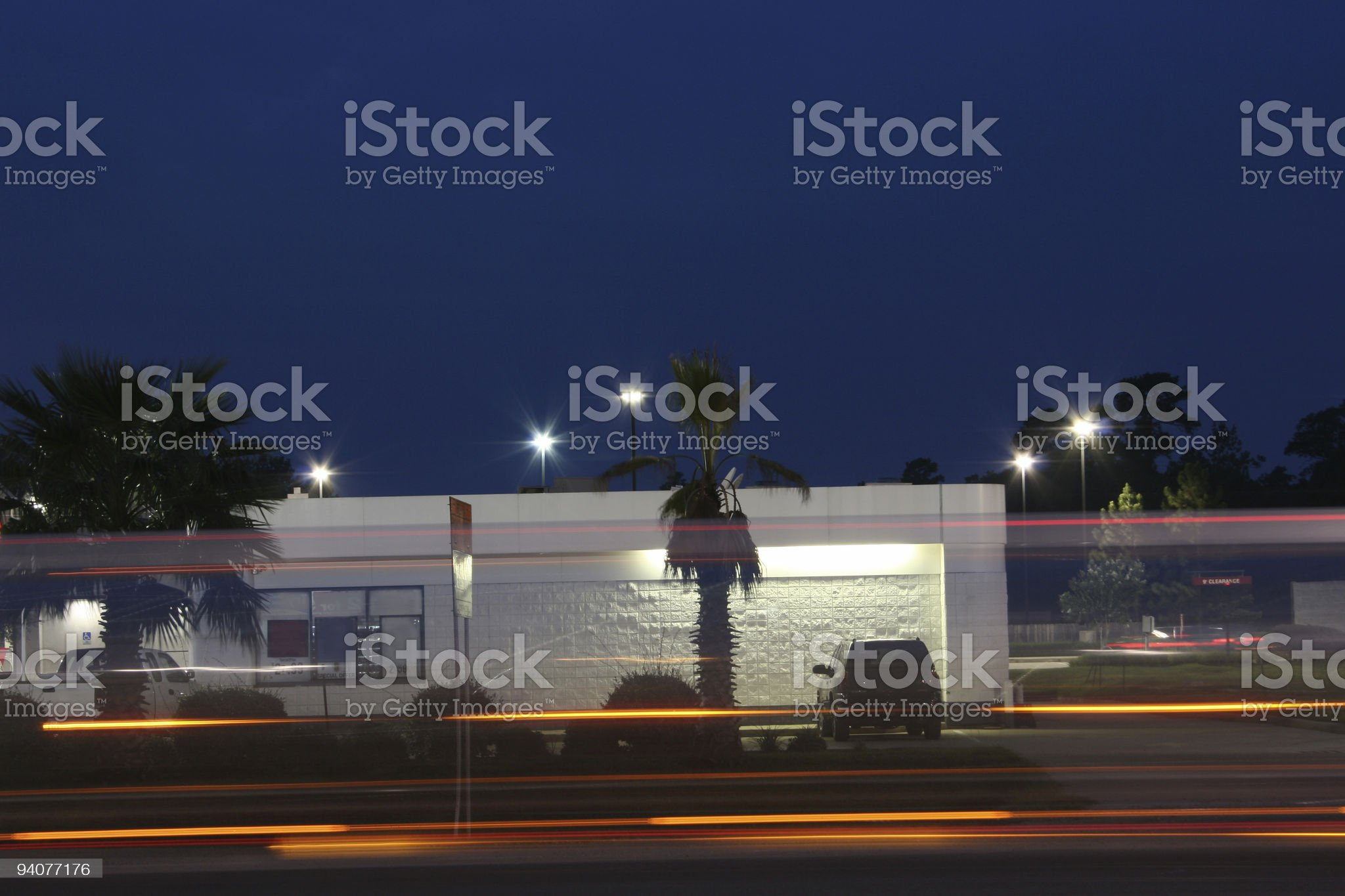Side of convenience store taken a dusk with traffic lights royalty-free stock photo