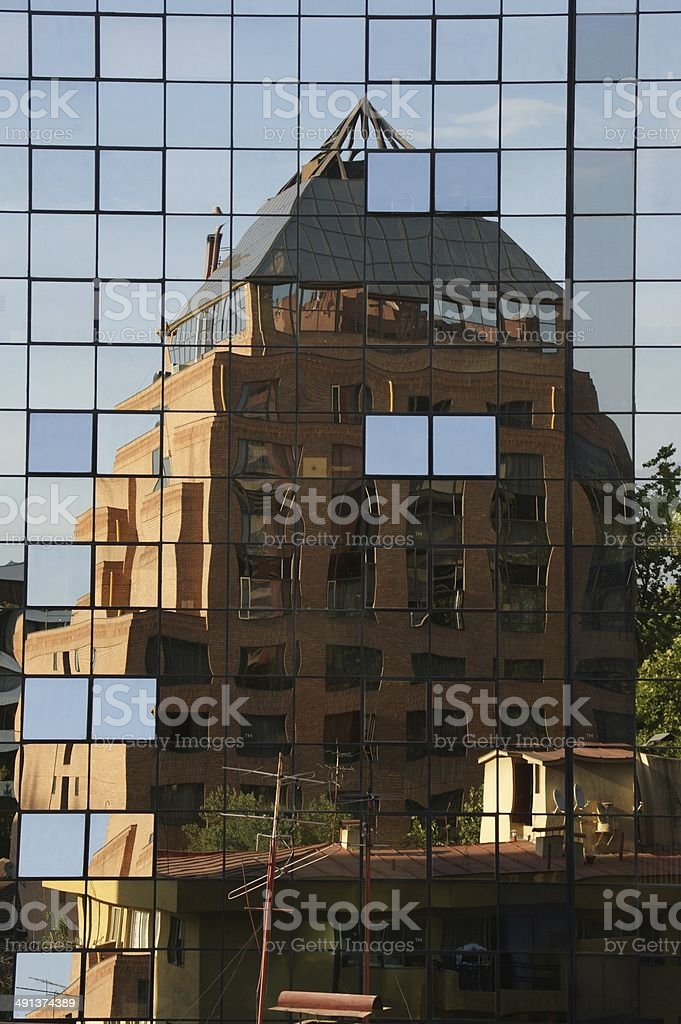 Side of skyscraper, with reflected building, Providencia, Santiago de Chile royalty-free stock photo