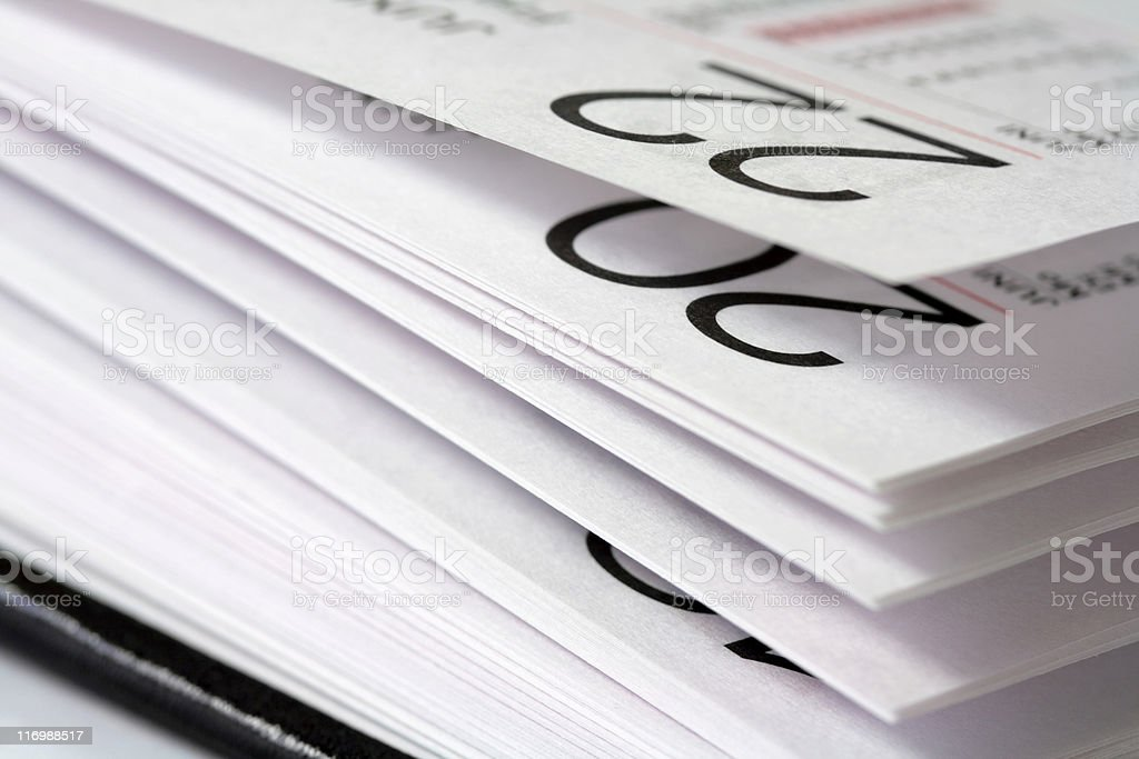 Side on view of an open one page a day diary stock photo