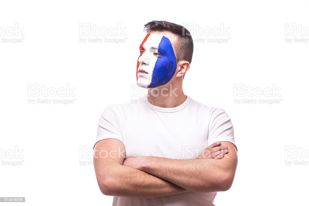 Side portrait football fan confident  of France national team. stock photo