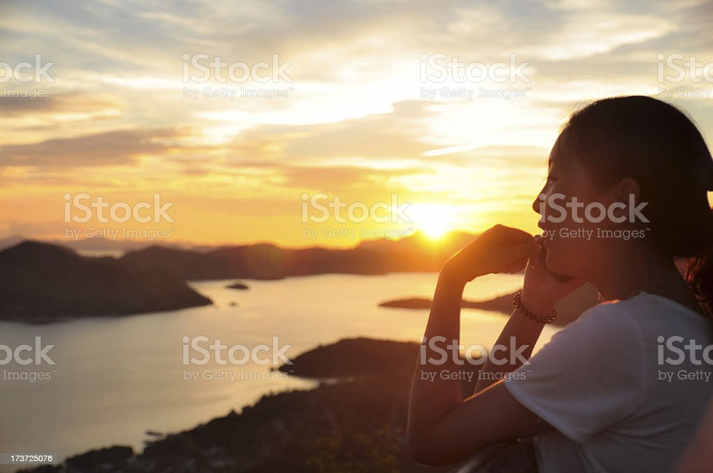 Side portrait of girl making phonecall when sunset royalty-free stock photo