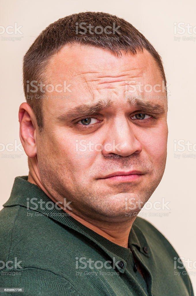 Side portrait of sad man on white background stock photo
