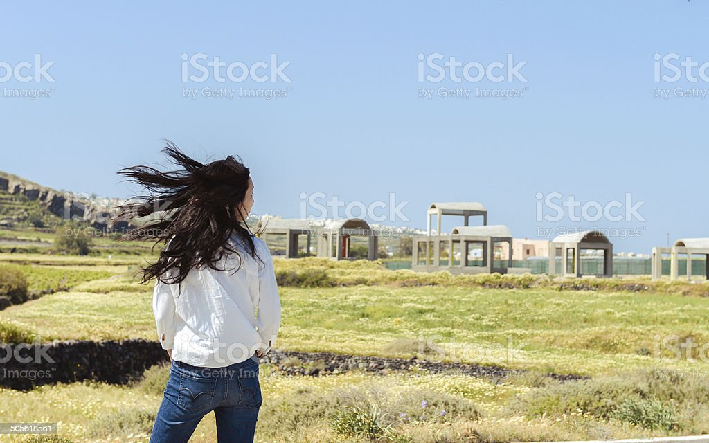 Side portrait of single girl turns around with flying hair royalty-free stock photo