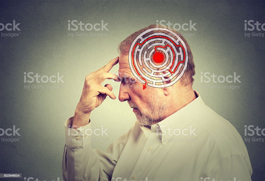 Side profile elderly man solving problem thinking stock photo