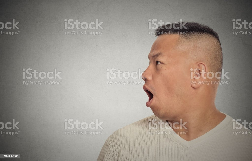 Side profile middle aged man speaking stock photo
