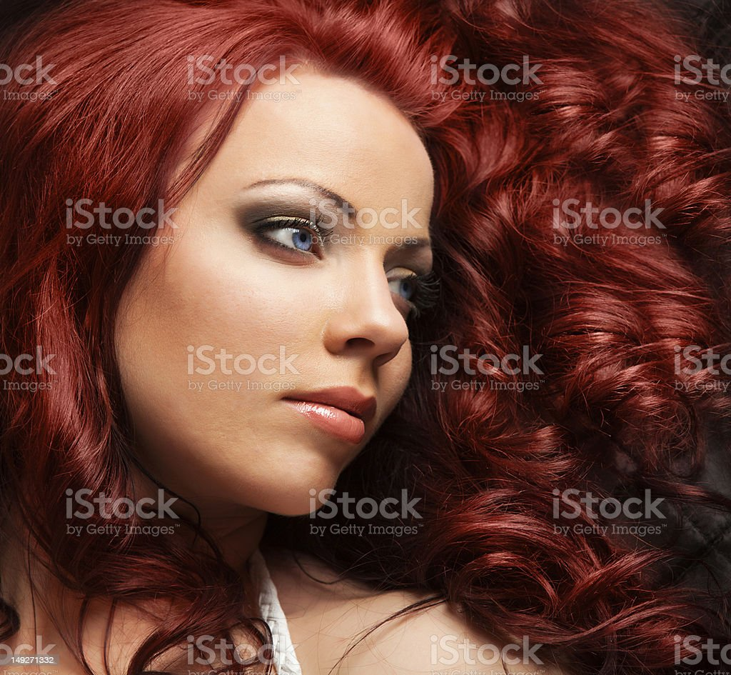 Side profile of a beautiful woman with red hair royalty-free stock photo