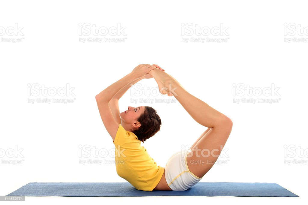 Side profile of a woman doing yoga stock photo