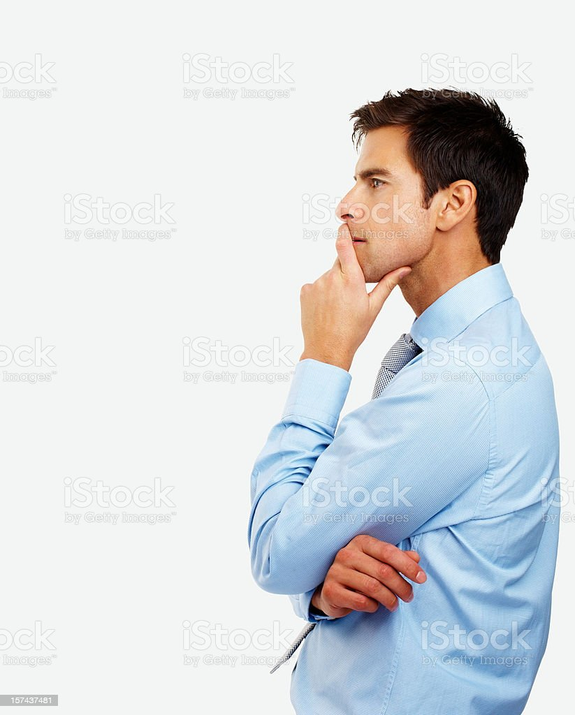 Side profile of a young businessman contemplating royalty-free stock photo