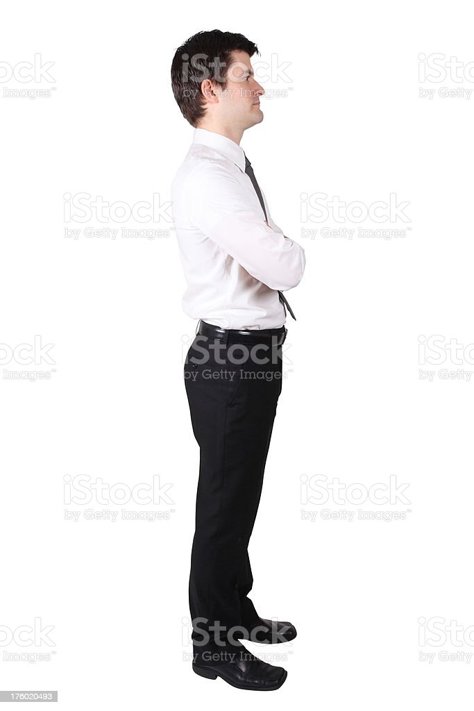 Side profile of businessman with arms folded royalty-free stock photo