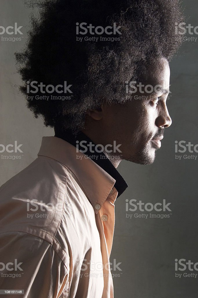 Side Profile of Man with Afro Hairstyle, Low Key royalty-free stock photo